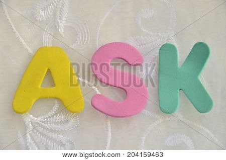 WORD ASK ON A  ANBSTRACT COLORFUL BACKGROUND