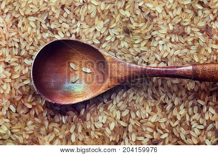 Brown Rice In A Wooden Spoon