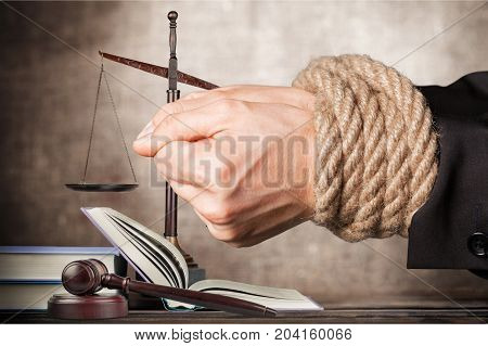 Hands justice rope scales background close-up paper