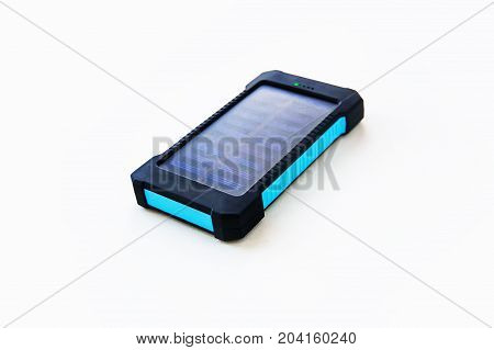 Portable charger for charging mobile devices. Camping hiking power Bank solar battery isolated on white background