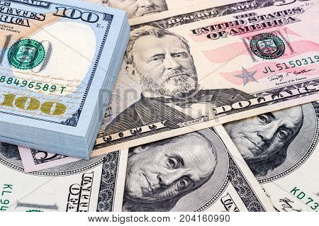 Heap of one hundred banknotes of american dollars close up