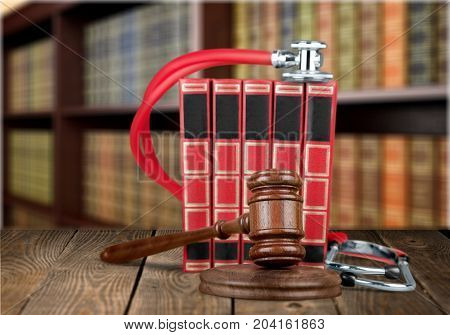 Red wooden books gavel background close-up paper