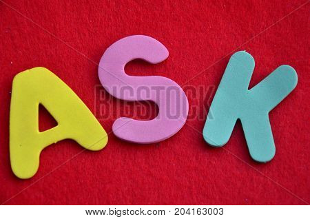 WORD ASK ON A  ABSTRACT RED BACKGROUND