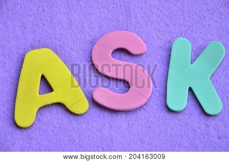 WORD ASK ON A  ABSTRACT BLUE BACKGROUND