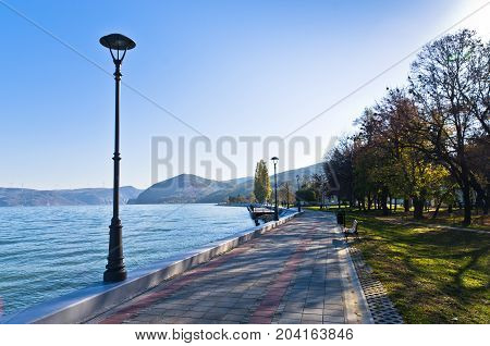 Danube river wide like a sea in front of Djerdap gorge entrance, a view from promenade at city of Golubac in Serbia