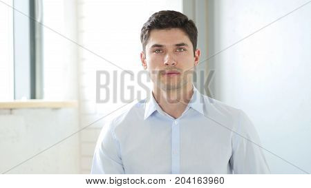 Portrait Of Man Face, Indoor In Office At Work