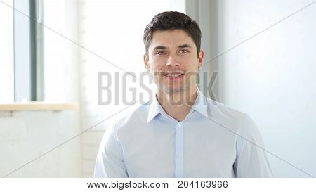 Smiling Man In Office, Indoor In Office At Work