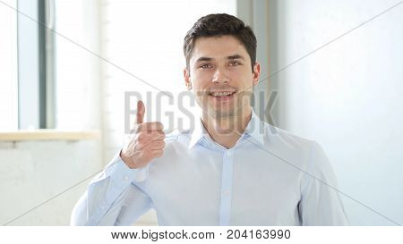 Thumbs Up By Man In Office, Indoor In Office At Work