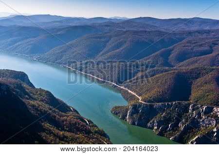 Hillsides of a surrounded mountains over Danube river at Djerdap gorge and national park in east Serbia