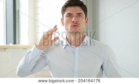 Frustrated Angry Man Yelling In Office At Work