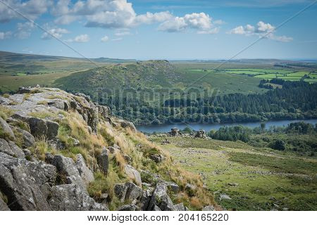 Leather tor on Dartmoor with Burrator reservoir in the background.