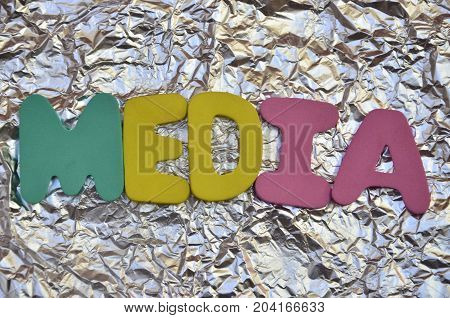 WORD MEDIA ON A  ABSTRACT COLORFUL BACKGROUND