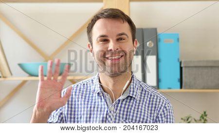 Video Chat, Talking Man  At Work In Office Via Webcam