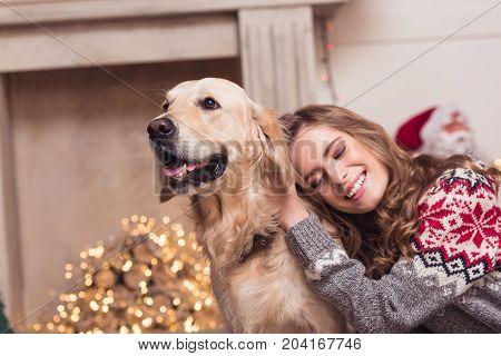 Young Woman And Dog At Christmastime