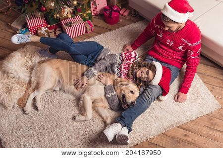Couple In Santa Hats With Dog