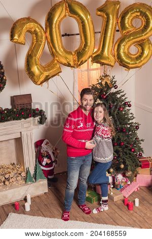 Couple With Golden 2018 Balloons