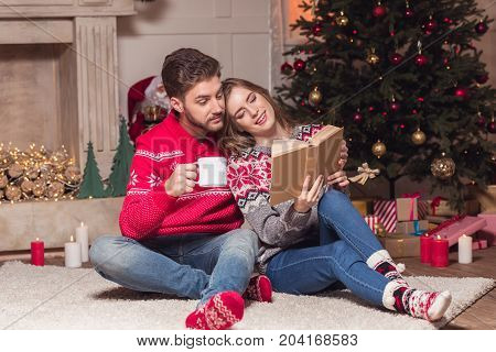 Couple Reading Book At Christmastime