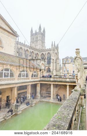 Bath UK - December 18 2016: View of inside Historic Roman Baths with Bath Abbey in the Historic Somerset Bath city United Kingdom.
