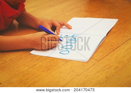 child learning to write numbers, kids learning and do homework