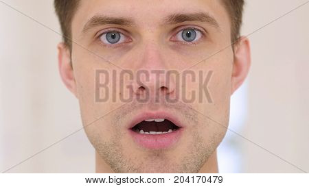 Young Man In Shock, Face Close Up At Work In Office
