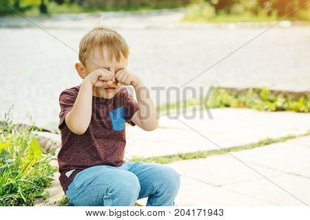 Little Kid Boy Crying On Summer Walk.