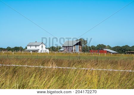 Landscape capture of an amish homestead from a public road.