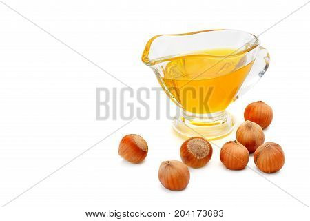 Oil and fruit hazelnut isolated on white background. Free space for text.