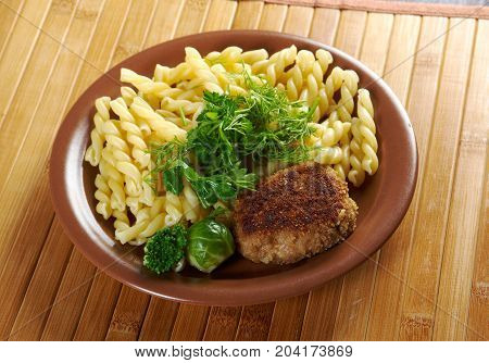 delicious macaroni pasta with beef cutlets, vegetableo n