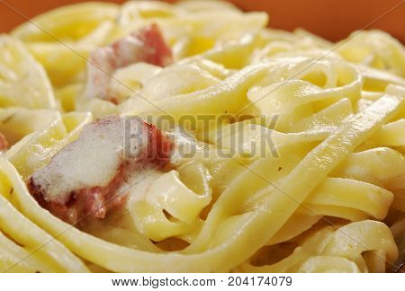 pasta Fettuccine Alfredo with sausage. close up homemade meal