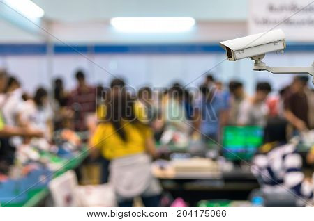 CCTV security camera on monitor the Abstract blurred photo of cashier store blur with bokeh background