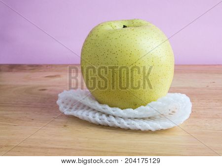 Chinese Pear With Epe Net Foam On The Wooden Table