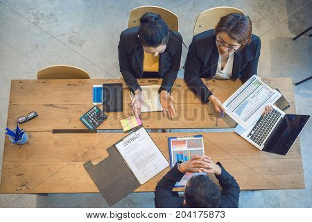 Top view business peoples meeting for analysis and plan business strategies.