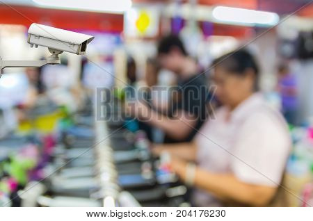CCTV security camera on monitor the Abstract blurred photo of store blur with customer choose product bokeh background