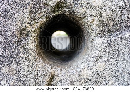 concrete hole see through close up abstract tunnel view design