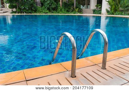 Luxury blue swimming pool with the garden
