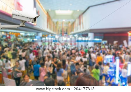 CCTV security camera on monitor the Abstract blurred photo of store blur with customer bokeh background
