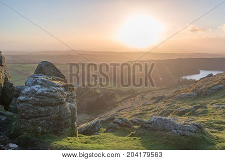 Sunset taken from Sheep's Tor on Dartmoor, with Burrator reservoir on the horizon.