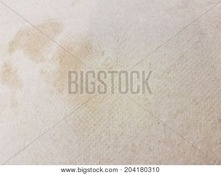 a grease stain on a light brown napkin