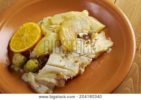 Fresh Halibut with sauce potatoesorange  , close up meal