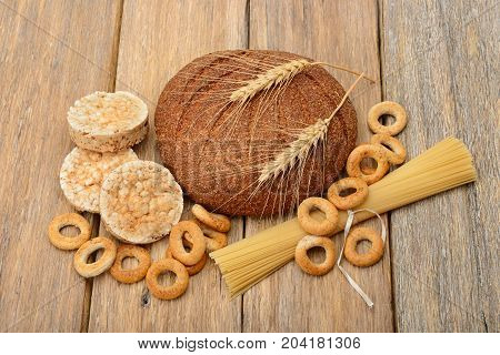 bread pasta and pastries on a wooden background