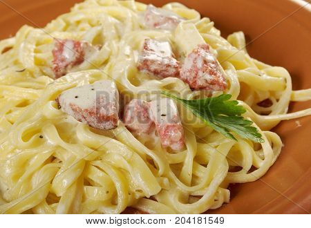 pasta Fettuccine Alfredo with sausage. close up traditional meal