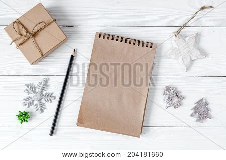 notebook and goals for new 2017 year on wooden background top view