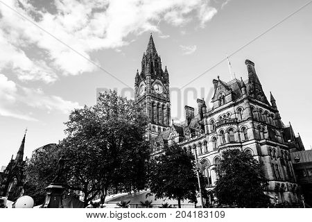 Manchester UK. Town Hall of Manchester UK with cloudy sky during the sunny day. Black and white