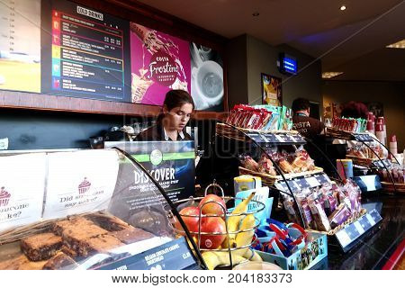Dover, England - August 18 2017: Costa Employee Serving Customers A Range Of Drinks And Snacks