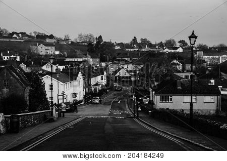 Cashel Ireland. Aerial view of small town Cashel in Tipperary County of Ireland colorful sunset sky. Black and white