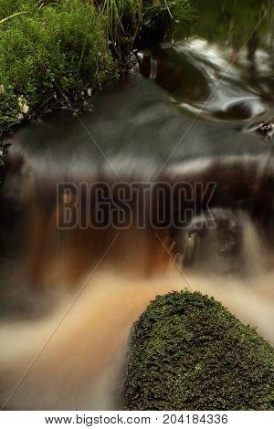 fast mountain stream cascade water long exposure soften