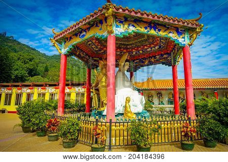 Pagoda with white Buddha statue at Ten Thousand Buddhas Monastery in Sha Tin, Hong Kong, China.