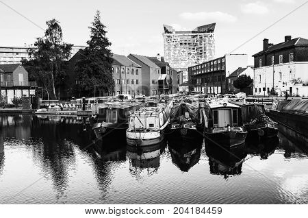 Birmingham UK. Boats moored in the evening at famous Birmingham canal in UK. Black and white