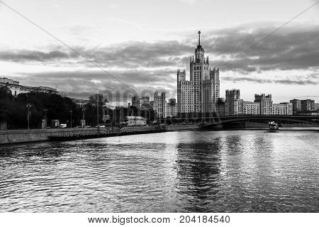 Boat ride in the evening in Moscow Russia. Famous landmarks. Sunset cloudy sky in the capital of Russia. Bridges over Moscow river. Black and white