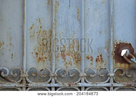 Iron gate rusty metal texture weathered background.